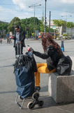 People waiting with suitcase in front of train station in Mulhouse royalty free stock photos