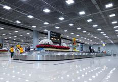 People Waiting Suitcase on luggage conveyor belt at baggage claim at Suvarnabhumi Airport Bangkok. stock photos