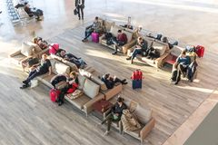 People waiting for their flight at departure terminal of Valencia Airport in Manises, also known as Manises Airport stock photos