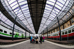 People waiting by their trolleys at Helsinki Central Trainstation, Finland royalty free stock photo