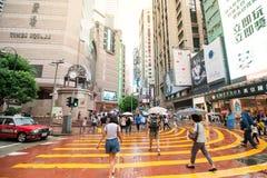 People waiting to cross through busy streets at Hong Kong Times. Hong Kong, China - October 03- 2015 : People waiting to cross through busy streets at Hong Kong Stock Photo