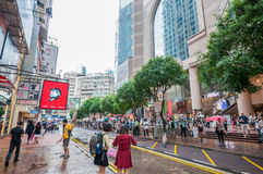 People waiting to cross through busy streets at Hong Kong Times Royalty Free Stock Photography
