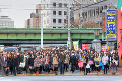 People are waiting to cross the road Stock Photo