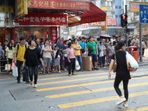 People Waiting to Cross the Street. Many people wait to cross the street in Hong Kong Stock Photography