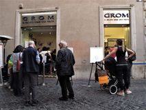 Grom ice cream. People waiting to enter to get ice cream royalty free stock photography