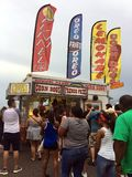 People Waiting in Line at Festival Food Stand. People waiting to order unhealthy food at outdoor carnival event. The stand is serving fried oreos, funnel cake stock photos