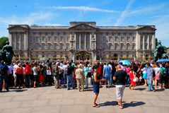 People waiting to see the changing the guard Stock Images