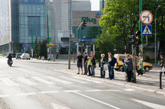 People waiting by the traffic lights Stock Image