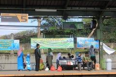 People Waiting A Train. Jakarta, Indonesia, 21 March 2012 - People were waiting a train at railway station in Jakarta stock photo