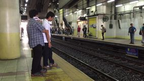 People waiting for the train in Manila stock video footage