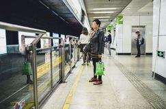 People waiting train in Shanghai metro, China. SHANGHAI, CHINA - MAY 08, 2016: Shanghai metro. People waiting a train Stock Photos