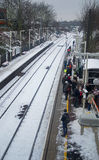 People waiting for the train after an snowfall Royalty Free Stock Images