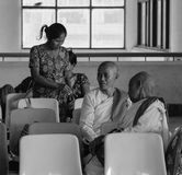 People waiting at train station in Yangon, Myanmar Stock Image