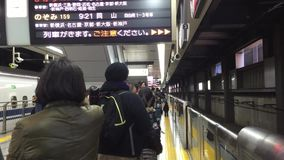 People waiting the train at the station in Yokohama, Japan.  stock footage