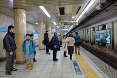 People waiting for the train at subway station in Kyoto Royalty Free Stock Images