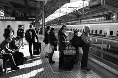 People waiting for train on the train station in Kyoto, Japan. Stock Photography