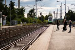 People waiting for the train in the Vammala station, Finland stock photography