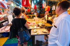 People waking in Bowrington Road Market. Royalty Free Stock Images