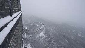 People are waling on the grat wall of China after a storm