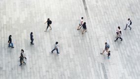 People walk on across business city street Aerial top view royalty free stock photography