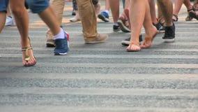 People walk across the road in slow motion stock video footage