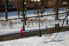 People walk in Alexanders Garden in Moscow in winter. Royalty Free Stock Photography