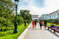People walk along Alexander garden by the Moscow Kremlin Royalty Free Stock Image