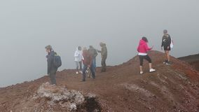 People walk along Crater Silvestri Superiori on mt.Etna, Sicily, Italy. People walk along the Crater Silvestri Superiori 2001m on Mount Etna, Etna national park stock footage