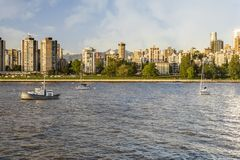 People walk along the embankment in the city with high modern ho Royalty Free Stock Photos