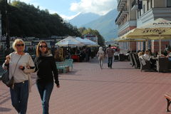 People walk along the enbankment. Rosa Khutor Royalty Free Stock Images