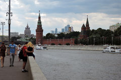 People walk along the Moscow river embankment. Stock Photo