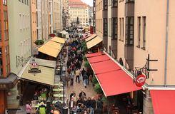 People walk along Munzgasse May 1, 2013 in Dresden, Germany. Royalty Free Stock Images