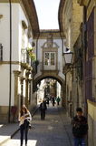 People walk along the one of most known street in Guimaraes, Portugal. GUIMARAES, PORTUGAL - APRIL 23 2015: People walk along the one of most known street on Stock Image