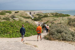 People walk along the path to Cape Skagen Royalty Free Stock Photos