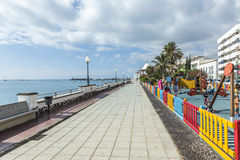 People walk along the promenade in Arrecife Stock Photography