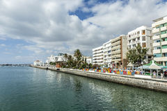 People walk along the promenade in Arrecife Stock Images