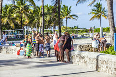People walk along the promenade at ocean drive in South Beach Royalty Free Stock Photo