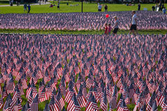 People walk through 20,000 American Flags. That, are displayed for every resident of Massachusetts who died in a war over the past 100 years, Boston Common Stock Photography