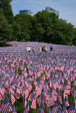 People walk through 20,000 American Flags Stock Images