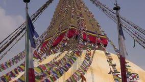 People walk around the Buddhist spiritual center Boudhanath Stupa stock video