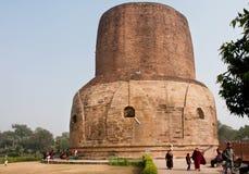 People walk around impressive 43.6 meters high Dhamek stupa Royalty Free Stock Image