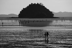 People walk around Pakmeng Beach. Stock Photo