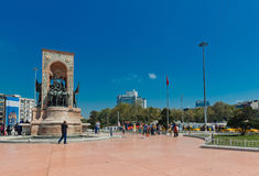 People walk around Republic Monument at Taksim Square in Istanbu Stock Photos