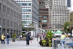 People walk around the South Street Seaport Square Stock Photos