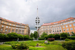 People walk around tall Zizkov Television Tower Stock Photos