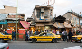 People walk arounf street market with line of taxi cars Royalty Free Stock Image