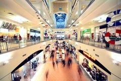People walk in Atrium Mall Royalty Free Stock Photos