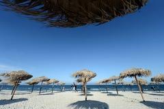 People walk on the beach Stock Photos