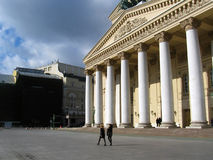 People walk by the Bolshoy Theater in Moscow. Stock Images