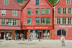 People walk at Bryggen in Bergen, Norway. Stock Images